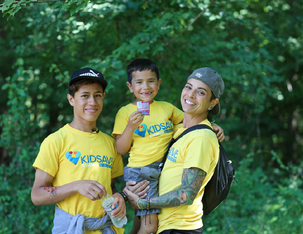 Andrea Uribe with their foster-children Ethan, 13, and Julian, 6, at a KIDSAVE event on July 31, 2021. (StatenIsland Advance/Alexandra Salmieri)
