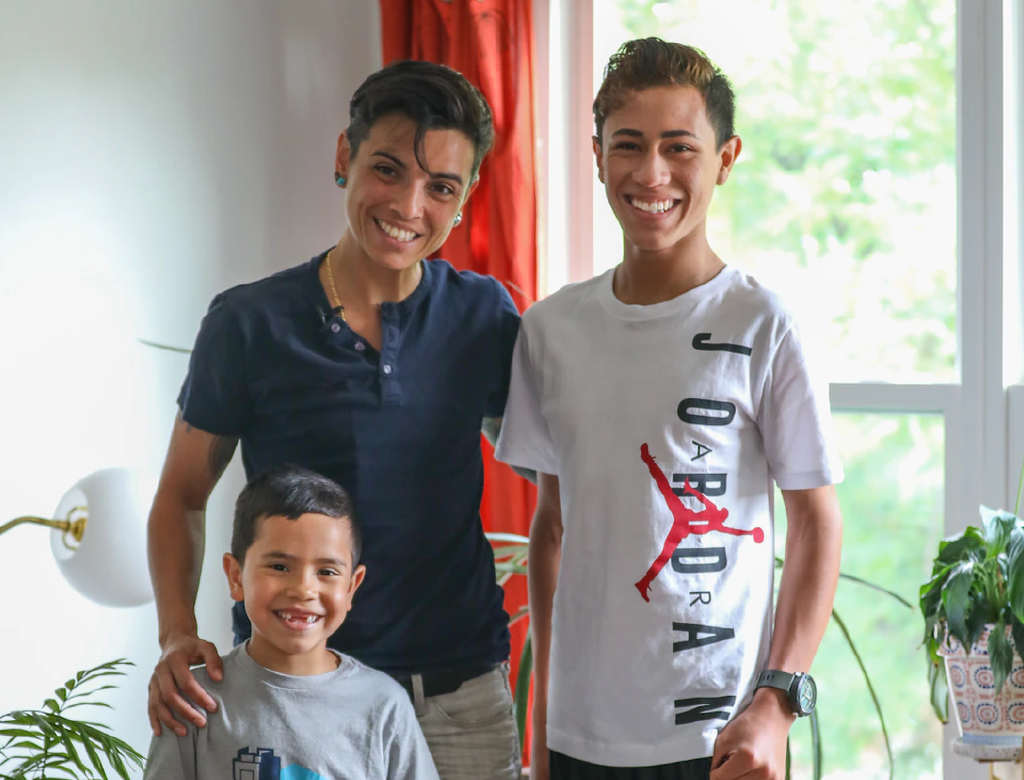 Andrea Uribe with their foster-children Ethan, 13, Julian, 6, and dog Lu, at their Huguenot home. (Staten Island Advance/Alexandra Salmieri)